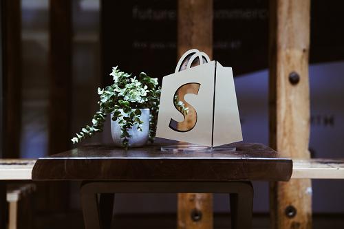 shopify-logo-window-with-plant - 500x333